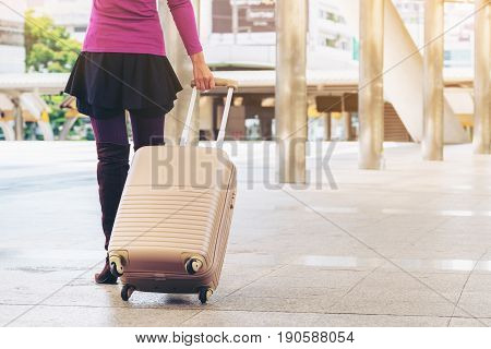 Woman Traveller In Airport Walkway. Travel Concept.