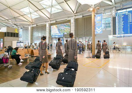 INCHEON, SOUTH KOREA - CIRCA JUNE, 2017: Asiana Airlines crew members at Incheon International Airport.