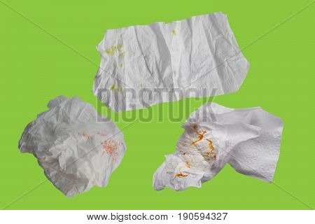 Piece paper tissue white isolated on green background with clipping path.
