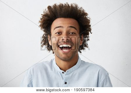 Carefree Joyful Handsome Afro American Man With Bushy Hairstyle And Bristle Having Shining Eyes Open
