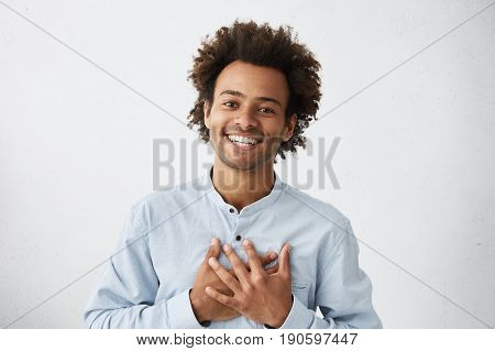 Lovely Good-natured Afro American Man In White Shirt Having Charming Smile And Friendly Expression H