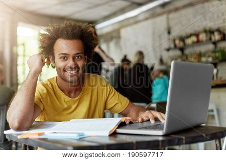 Happy Positive African American College Student With Cheerful Cute Smile Using Wireless Internet Con