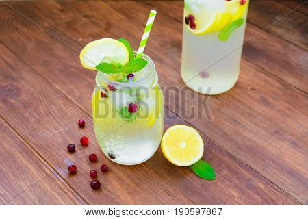 Jug With Detox Water With Lemons, Mint, Ice And Cranberry