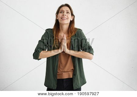 Headshot Of Young Student Female In Casual Clothes Begging For Good Luck At Exam. Pretty Woman With