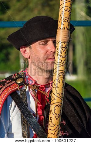 """Piestany, Slovakia – May 19 2017: An Unidentified Man, Dressed In Folk Costume, Plays The """"fujara"""" ("""