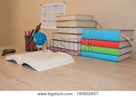 Book hardback colorful books on wooden table. Education and school concept