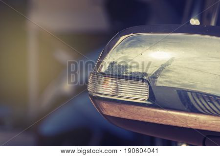 Car side mirror Vintage tone blur background
