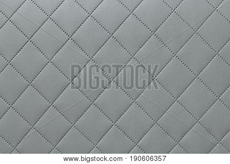 detail of sewn leather gray leather upholstery background pattern