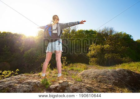 woman backpacker enjoy the view in forest on the path during summer. Travel hiking backpacking tourism and people concept