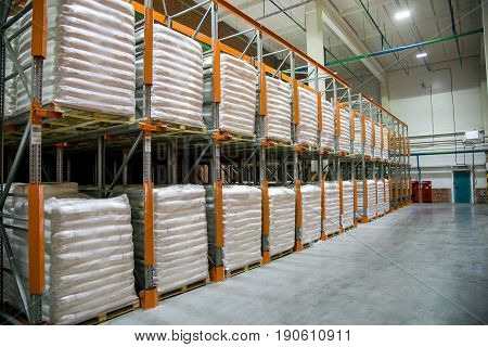 Finished chemical production in big polyethylene bags in warehouse