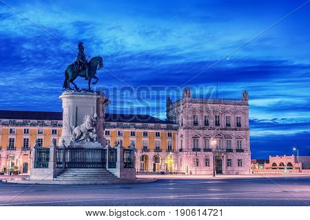 Lisbon, Portugal: the Triumphal Rua Augusta Arch, Arco Triunfal da Rua Augusta, Praca do Comercio and Statue of King Jose I at sunrise