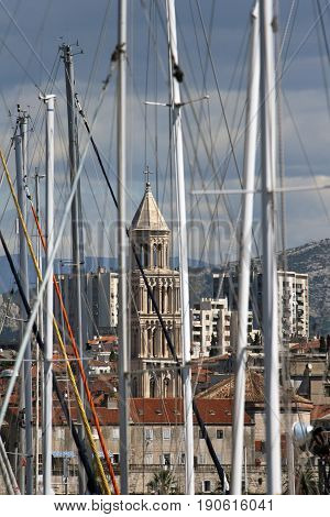 Bell Tower of St Domnius cathedral between the masts in Split harbor in Croatia