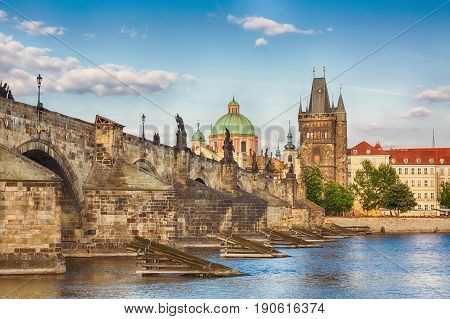 Prague, Czech Republic famous view with historic Charles Bridge and Vltava river during nice summer day.