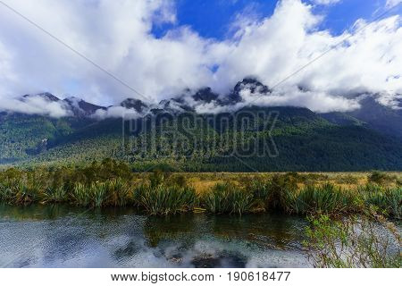 Mirror lake The famous tourism attraction in Fiordland National Park on Milford Road South Island of New Zealand