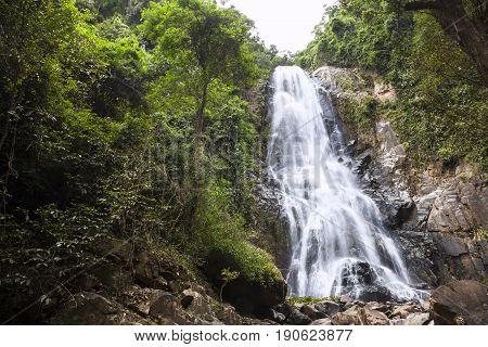 Natural background waterfall Colorful leaves waterfall thailand tropical Khao Nan National ParkSunanta Waterfall Nakhon Si Thammarat Thailand.