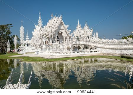 CHIANG RAI, THAILAND - FEBRUARY 4, 2016: Famous ornate Wat Rong Khun (White Temple) in Chiang Rai northern Thailand. Thus unconventional Buddhist temple is an ongoing project.
