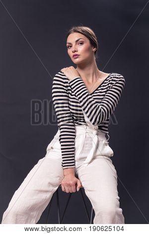 One Young Caucasian Woman 20S, 20-29 Years, Fashion Model Sitting Bar Stool, Posing, Studio, White B