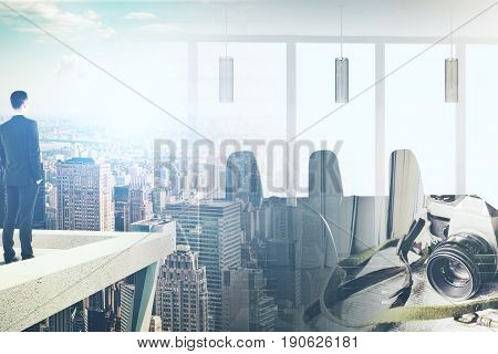 Back view of man standing on rooftop. Abstract city background with sunlight camera and meeting room. Double exposure