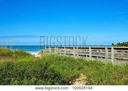 Wooden Beach Boardwalk leading to a white sandy Gulf Coast Beach