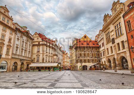 Buildings on the Old Town square Staromestska Namesti in Prague during sunrise Czech Republic.