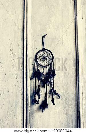 Black Dream Catcher on a gray wall.