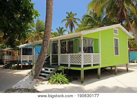 Cabins on stilts on the small island of Tobacco Caye, Belize, Central America
