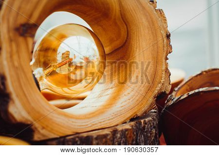 Old light bulb stuck in a wooden lamp