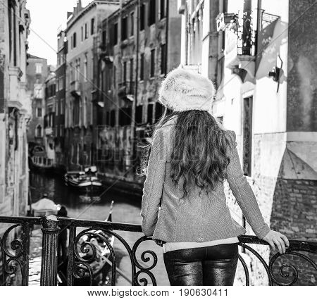Seen From Behind Tourist Woman In Venice, Italy Having Excursion