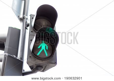 Traffic lights with the green light lit for pedestrians. Isolated on white background.