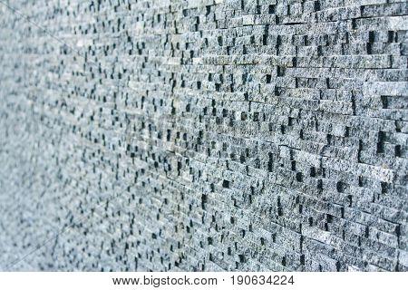 Dark grey stone tile dbrick wall backgrounf