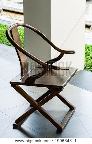 Glossy coating oak color wooden chair with armrest