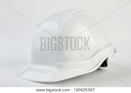 White safety helmet for foreman. Plastic head equipment on manufacture.