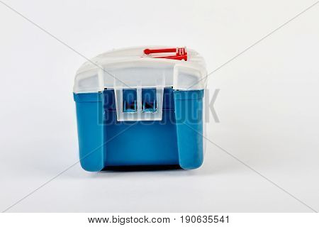 Blue fishing tackle box isolated. Plastic portable container, white background.