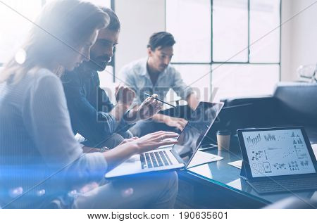 Business meeting concept.Coworkers team working with mobile computer at modern office.Analyze business plans, using laptop.Blurred background.Horizontal