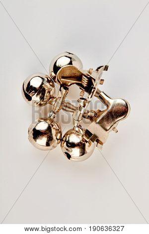 Golden metal fishing bells. Steel fishing bells, top view.