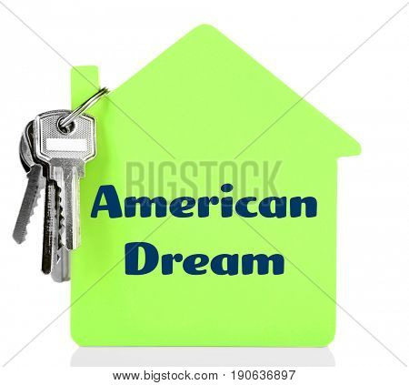 Text AMERICAN DREAM on house model and keys, white background