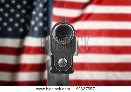 Firearm and American flag on background. Gun control concept