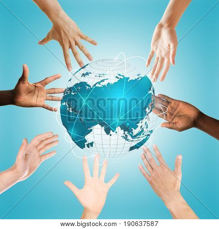 Hands surrounding globe on blue background. Concept of worldwide unity and environment protection
