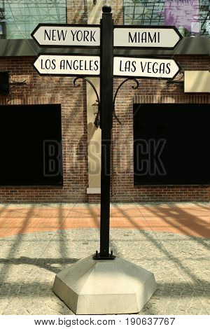 Signpost with different directions on street. Travel USA concept