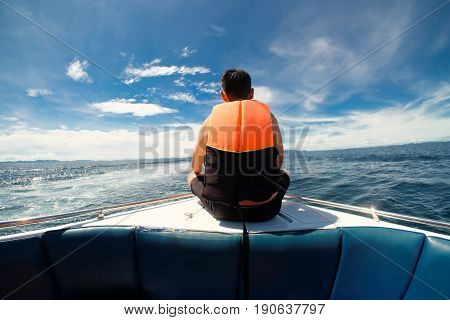 Man in life orange life jackets in a speed boat at Island Phuket Andaman Thailand break my heart concept