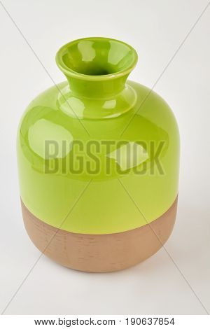 Two-tone shiny vase isolated. Elegant ceramic vase, white background. Trendy pottery at home.