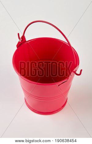 Single empty metal bucket isolated. Red metal decorative bucket on white background.