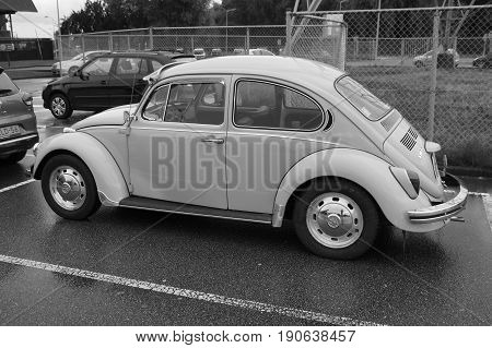 Muiden, The Netherlands - August 9, 2016: Volkswagen Type 1 parked on a public parking lot in the city of Muiden. Nobody in the vehicle. The VW T1 is also known as Beetle, Bug