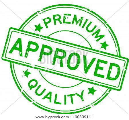 Grunge green premium quality approved round rubber seal stamp on white background