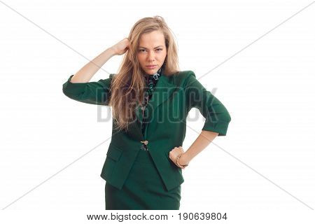 Charming youn business woman in green uniform posing on camera isolated on white background