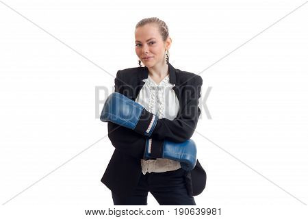Beautiful blonde business woman in classic unifrom with blue boxing gloves smiling on camera isolated on white background