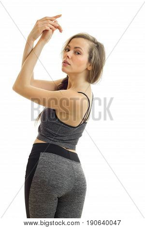 Vertical portrait of charming blonde sports woman in unifrom isolated on white background