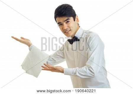 young friendly waiter smiles at the camera isolated on white background