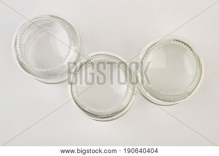 Unlabeled empty glass jars isolated. Clear glassware objects, top view.