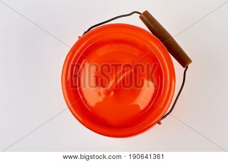 Enameled lidded jug isolated. Red jug for milk, white background.